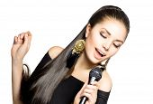 Singing Woman. Beautiful Singing Girl. Beauty Woman with Microphone over White Background. Singer. K