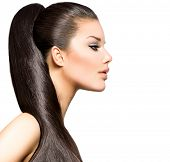Ponytail Hairstyle. Beauty Brunette Fashion Model Girl with Long Healthy Straight Brown Hair. Beauti
