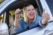 stock photo of car key  - Attractive Happy Woman In New Car with Keys - JPG