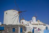 Santorini windmill against a blue sky Greece