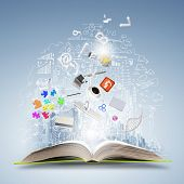 image of idealistic  - Opened book with business sketches and concept icons - JPG