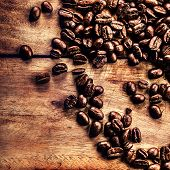 Roasted  Coffee Beans On Vintage Table. Coffee On Grunge Wooden Background Close Up.