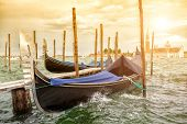 Gondolas on sunset against San Giorgio Maggiore church, Grand Canal in Venice