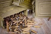 pic of cartridge  - box of ammunition with empty cartridges on wooden table - JPG