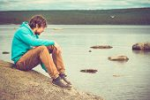 image of boy scout  - Young Man relaxing outdoor on mountain with lake on background Summer vacations and Lifestyle hiking concept - JPG