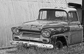 An Old Chevy Pickup Truck In A Junkyard
