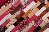 stock photo of quilt  - red and brown quilt patchwork texture background - JPG