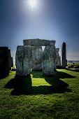 foto of stonehenge  - Stonehenge detail against the rising sun - JPG