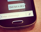 Cell phone message Don't Text & Drive close up