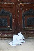 Letters on floor at front door