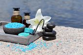 Herbal remedies for massage, on wooden tray, outdoor
