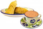 Colombian cuisine. Hot chocolate with envueltos of corn.