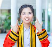 Graduate Thai College Girl Is Is Holding Poles And Smiling Happily For The Moment