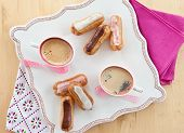 stock photo of eclairs  - Hot coffee and a variety of little french eclairs - JPG