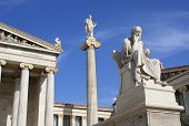 stock photo of socrates  - Image shows part of the main building of the Academy of Athens with ionic columns statue of god Apollo on top of a pillar with his and ancient Greek philosopher Socrates sitting - JPG