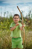 Boy Playing With Wooden Bow