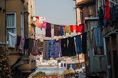stock photo of clotheslines  - Traditional street and houses with clotheslines at Balat district of Istanbul Turkey - JPG