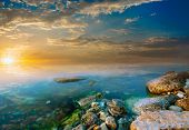 Coastal Rocks And Sunset