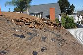 Demolition and removal of an Old Asphalt Single roof that was installed over an old Cedar Shake Roof