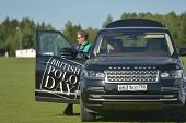 TSELEEVO, MOSCOW REGION, RUSSIA - JULY 26, 2014: British polo players in the Range Rover car during the British Polo Day. It was the second British Polo Day in Russia