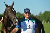 TSELEEVO, MOSCOW REGION, RUSSIA - JULY 26, 2014: Alexis Rodzianko holds the best polo pony during the British Polo Day. Tseleevo Golf & Polo Club hosts the event for the second time