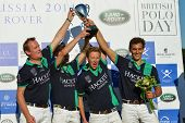 TSELEEVO, MOSCOW REGION, RUSSIA - JULY 26, 2014: Oxbridge Polo Team with prize during the award ceremony of the British Polo Day. Oxbridge beat Tseleevo Polo Club 5-4