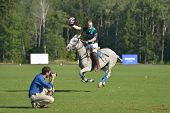 TSELEEVO, MOSCOW REGION, RUSSIA - JULY 26, 2014: Tom Hudson of Oxbridge Polo Team celebrates the vic