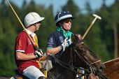 TSELEEVO, MOSCOW REGION, RUSSIA - JULY 26, 2014: Sam Browne of Oxbridge Polo Team (right) and Pavel