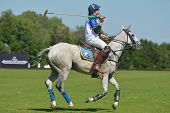 TSELEEVO, MOSCOW REGION, RUSSIA - JULY 26, 2014: Esteban Panelo of Moscow Polo club in action in the match against the team of British Schools during the British Polo Day. Moscow Polo Club won 7-6