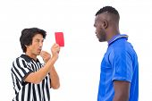 Referee sending off football player on white background