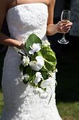 Bride Holding A Bouquet Of Flowers And Drink
