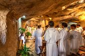 JERUSALEM, ISRAEL - JULY 13, 2014: Franciscan monks pray in Grotto of Gethsemane - chapel located in