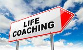 Life Coaching Inscription on Red Road Sign.