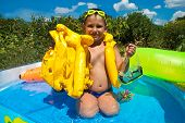 Little Boy In A Lifejacket
