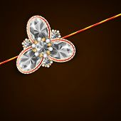 Beautiful shiny Rakhi on brown background for the occasion of Raksha Bandhan festival.