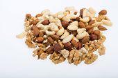 mixed nuts - hazelnuts walnuts cashews pine nuts isolated on white background