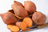 stock photo of batata  - close up of batata sweet potatoes and kitchen knife - JPG