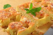 picture of sponge-cake  - detail of sliced sponge cake with almond flakes and mint - JPG