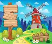 Scenery with sign and windmill - eps10 vector illustration.