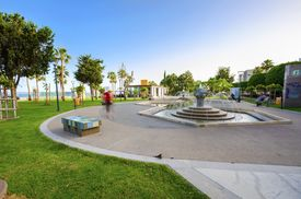 stock photo of fountain grass  - A view of Molos Promenade on the coast of Limassol city in Cyprus - JPG