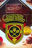 Kiev,Ukraine.Dec 20.Illustrative editorial.Chevron of Ukrainian National Guard.With logo Roshen Inc. Trademark Roshen is property of ukrainian president Poroshenko.At December 20,2014 in Kiev,Ukraine