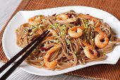 stock photo of sesame seed  - buckwheat soba noodles with shrimp and sesame seeds on a plate close - JPG
