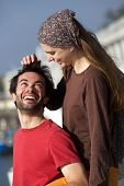 Happy Young Playful Couple Smiling Together Outdoors