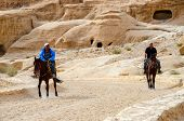 Jordan, Petra. Riders On The Road In The Canyon