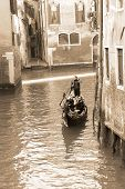 Gondolier Carrying Tourists In Venice, Sepia Tone