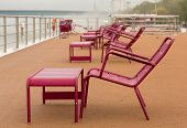 Chairs On Deck Of River Cruise Boat In Rain