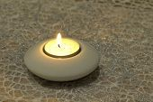 burning candle on a glitter background