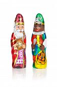 Closeup of Sinterklaas and Black Pete. Saint  Nicholas chocolate figurine of  Dutch character of Santa Claus.Isolated on white background.