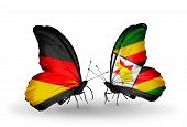 Two Butterflies With Flags On Wings As Symbol Of Relations Germany And Zimbabwe