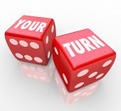 Your Turn words on two red dice to illustrate the next move in a game, event or competition for you to win with a great performance and achieve success over other players